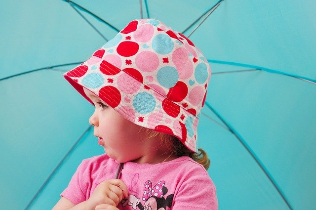 A little girl with a pink umbrella
